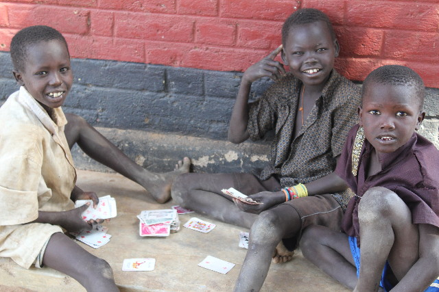 Soap For South Sudan kids playing cards in a refugee camp